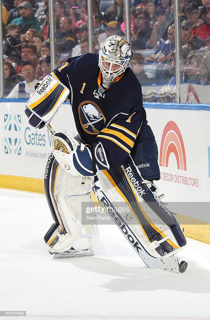 <a gi-track='captionPersonalityLinkClicked' href=/galleries/search?phrase=Jhonas+Enroth&family=editorial&specificpeople=570456 ng-click='$event.stopPropagation()'>Jhonas Enroth</a> #1 of the Buffalo Sabres clears the puck out from behind the net against the Winnipeg Jets during the third period at First Niagara Center on April 22, 2013 in Buffalo, New York. Winnipeg defeated Buffalo, 2-1.