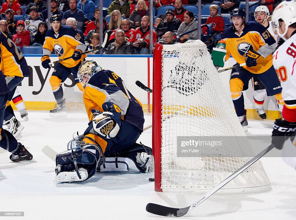 Jhonas Enroth #1 of the Buffalo Sabres guards the net as the puck crosses the goal line during the first period against the Calgary Flames at First Niagara Center on December 14, 2013 in Buffalo, New York. Officials called no goal after the Flames received a penalty on the play.
