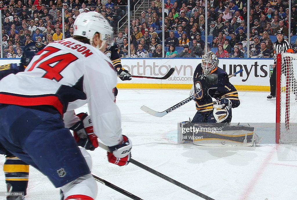 <a gi-track='captionPersonalityLinkClicked' href=/galleries/search?phrase=Jhonas+Enroth&family=editorial&specificpeople=570456 ng-click='$event.stopPropagation()'>Jhonas Enroth</a> #1 of the Buffalo Sabres keeps his eye on the puck on a shot from John Carlson #74 of the Washington Capitals on March 30, 2013 at the First Niagara Center in Buffalo, New York.