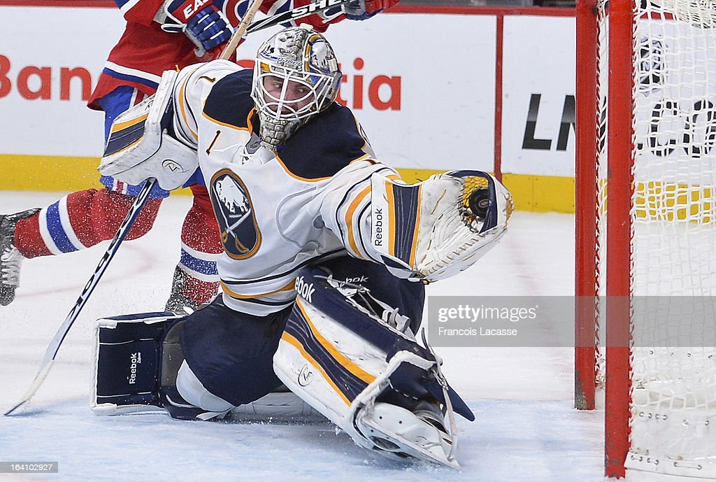 <a gi-track='captionPersonalityLinkClicked' href=/galleries/search?phrase=Jhonas+Enroth&family=editorial&specificpeople=570456 ng-click='$event.stopPropagation()'>Jhonas Enroth</a> #1 of the Buffalo Sabres makes a glove save during the NHL game against the Montreal Canadiens on March 19, 2013 at the Bell Centre in Montreal, Quebec, Canada.