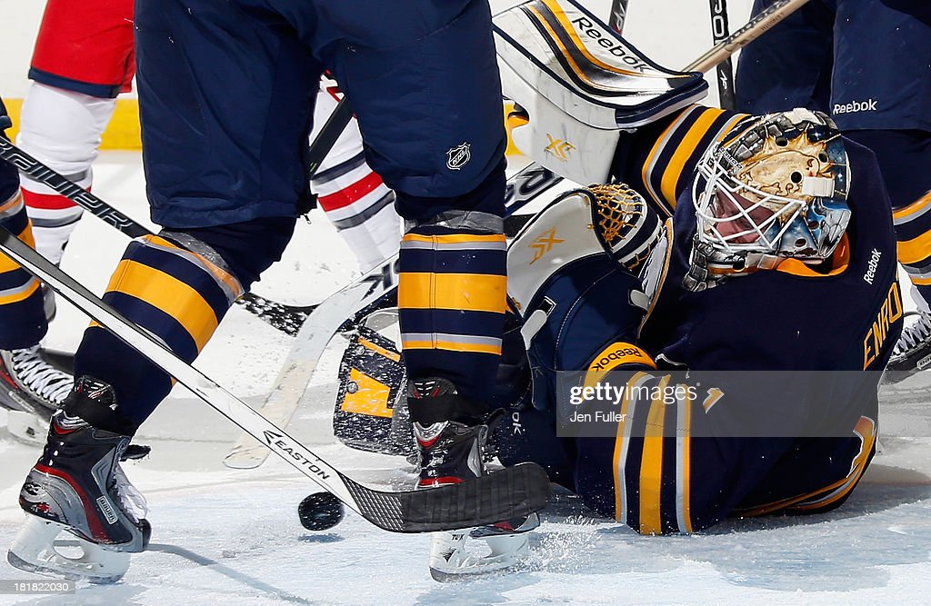 Jhonas Enroth #1 of the Buffalo Sabres makes a save against the Columbus Blue Jackets during their preseason game at First Niagara Center on September 25, 2013 in Buffalo, New York. Buffalo defeated Columbus, 3-0.