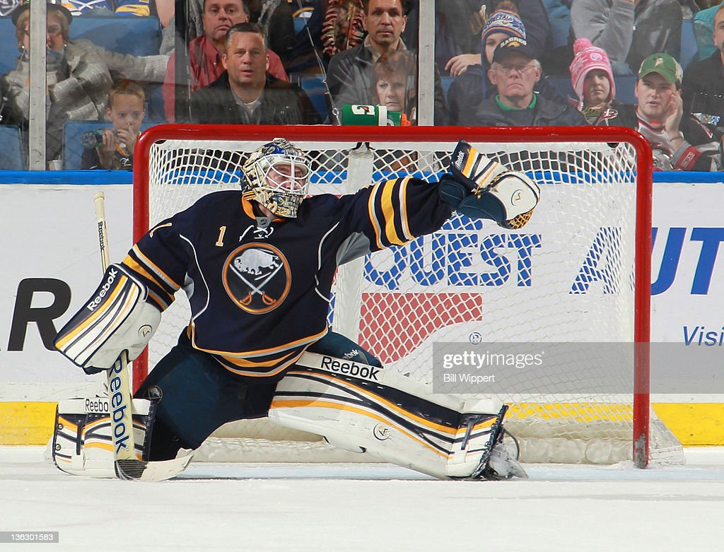 <a gi-track='captionPersonalityLinkClicked' href=/galleries/search?phrase=Jhonas+Enroth&family=editorial&specificpeople=570456 ng-click='$event.stopPropagation()'>Jhonas Enroth</a> #1 of the Buffalo Sabres makes a third-period glove save on a shot by Filip Kuba of the Ottawa Senators at First Niagara Center on December 31, 2011 in Buffalo, New York.