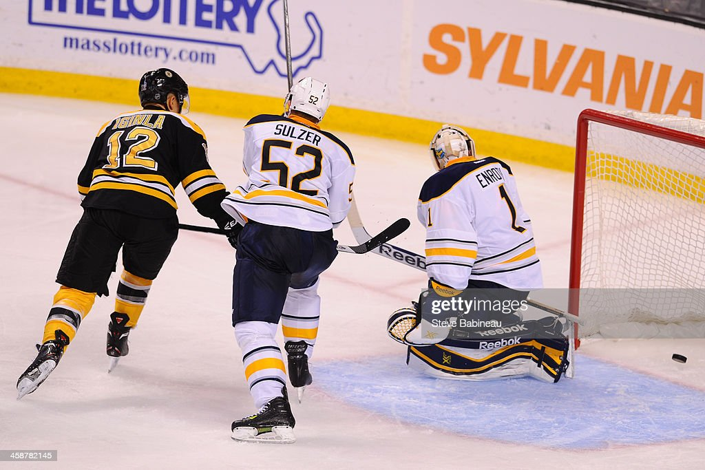 <a gi-track='captionPersonalityLinkClicked' href=/galleries/search?phrase=Jhonas+Enroth&family=editorial&specificpeople=570456 ng-click='$event.stopPropagation()'>Jhonas Enroth</a> #1 of the Buffalo Sabres misses the puck to let in a goal against the Boston Bruins at the TD Garden on December 21, 2013 in Boston, Massachusetts.