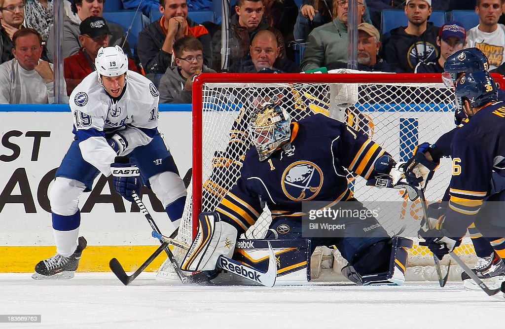 <a gi-track='captionPersonalityLinkClicked' href=/galleries/search?phrase=Jhonas+Enroth&family=editorial&specificpeople=570456 ng-click='$event.stopPropagation()'>Jhonas Enroth</a> #1 of the Buffalo Sabres stops a wrap-around scoring attempt by <a gi-track='captionPersonalityLinkClicked' href=/galleries/search?phrase=B.J.+Crombeen&family=editorial&specificpeople=4505846 ng-click='$event.stopPropagation()'>B.J. Crombeen</a> #19 of the Tampa Bay Lightning on October 8, 2013 at the First Niagara Center in Buffalo, New York. Tampa Bay won, 3-2.