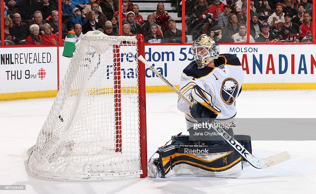 Jhonas Enroth #1 of the Buffalo Sabres watches the late third period game winning goal sail over his shoulder during an NHL game against the Ottawa Senators at Canadian Tire Centre on February 6, 2014 in Ottawa, Ontario, Canada.