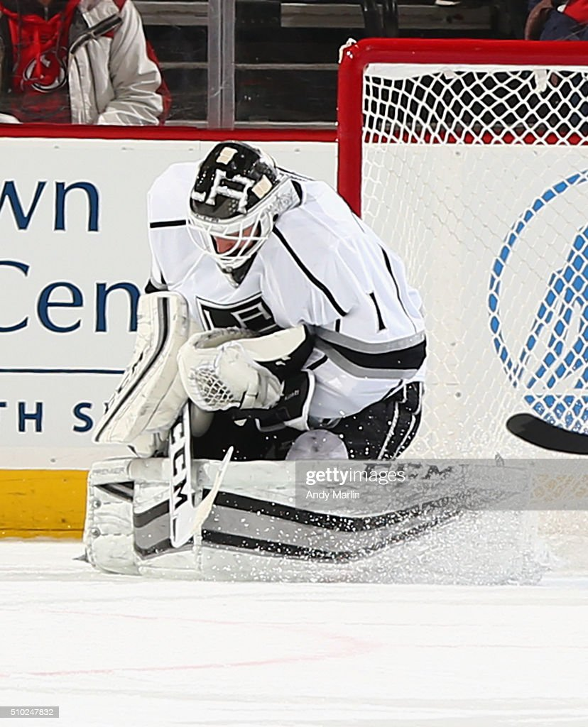 Jhonas Enroth #1 of the Los Angeles Kings makes a save against the New Jersey Devils during the game at the Prudential Center on February 14, 2016 in Newark, New Jersey.