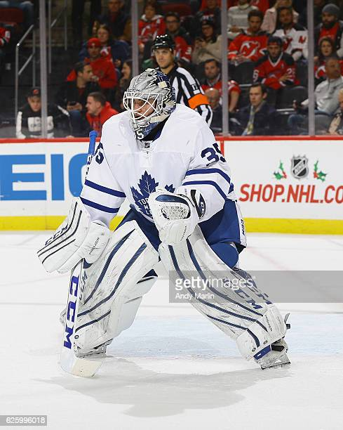 Jhonas Enroth of the Toronto Maple Leafs defends his net against the New Jersey Devils during the game at Prudential Center on November 23 2016 in...