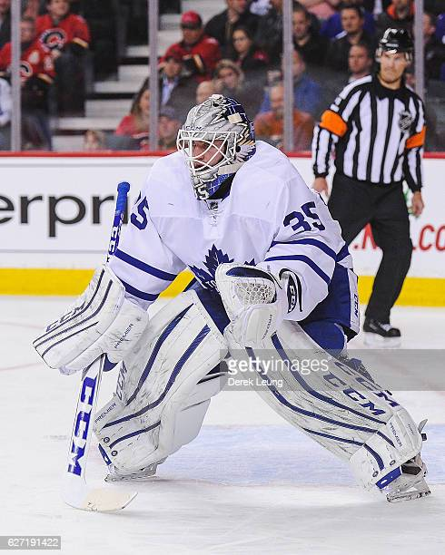 Jhonas Enroth of the Toronto Maple Leafs in action against the Calgary Flames during an NHL game at Scotiabank Saddledome on November 30 2016 in...