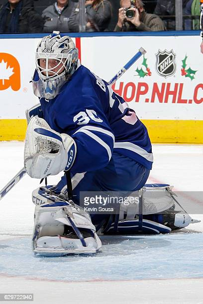 Jhonas Enroth of the Toronto Maple Leafs looks for the puck during the third period at an NHL game against the Colorado Avalanche at the Air Canada...