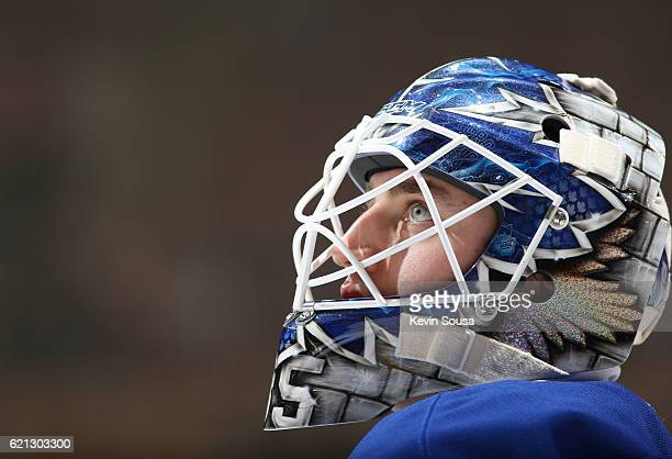 Jhonas Enroth of the Toronto Maple Leafs takes part in warm up prior to the first period against the Vancouver Canucks at the Air Canada Centre on...