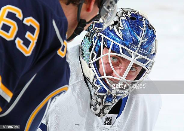 Jhonas Enroth of the Toronto Maple Leafs talks to former teammate Tyler Ennis of the Buffalo Sabres before an NHL game at the KeyBank Center on...