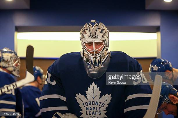 Jhonas Enroth of the Toronto Maple Leafs waits to take the ice for warmup with teammates before playing the Colorado Avalanche at the Air Canada...