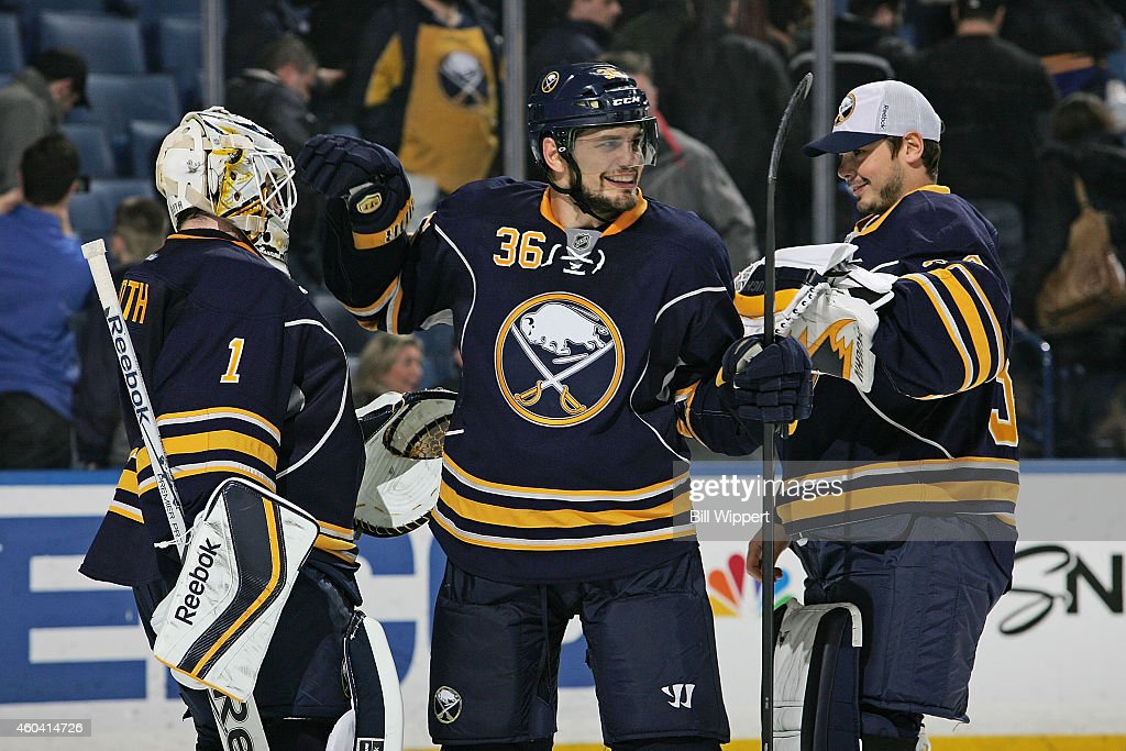 Jhonas Enroth Patrick Kaleta and Michal Neuvirth of the Buffalo Sabres celebrate a win against the Los Angeles Kings on December 9 2014 at the First...