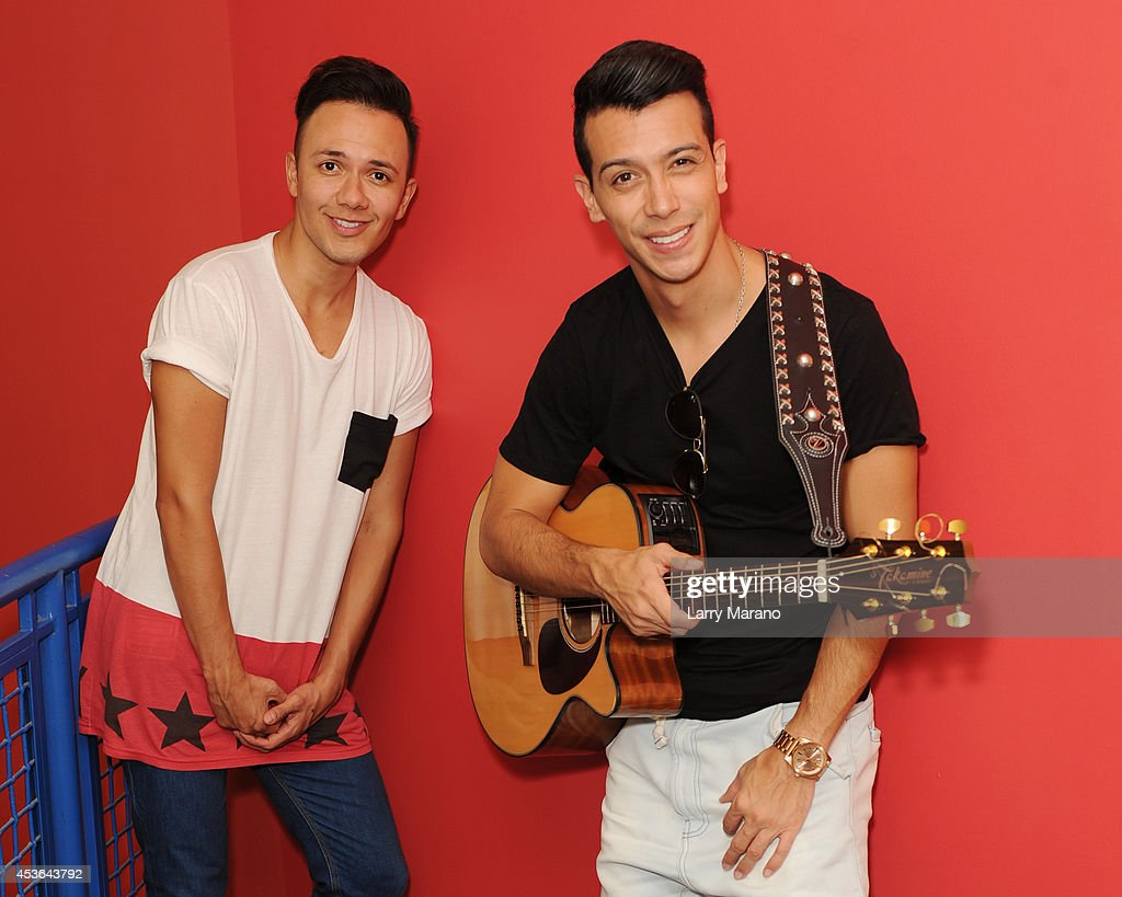 Jhonatan Hernandez and Gabriel Rodriguez of Pasabordo pose for a portrait Mega 94.9 on August 14, 2014 in Miami, Florida.