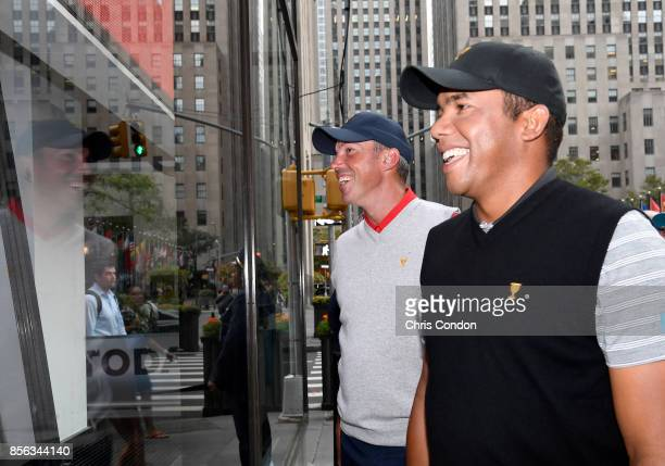 Jhonattan Vegas of Venezuela and the International Team and Matt Kuchar of the US Team smile outside the window while on the Today Show prior to the...