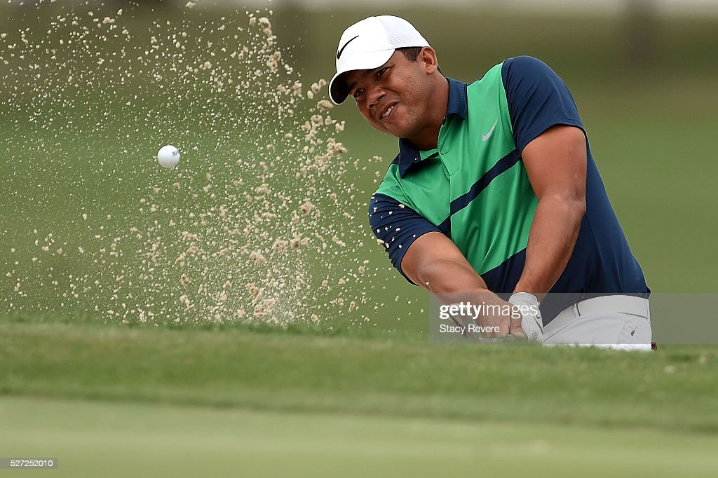 Jhonattan Vegas of Venezuela hits from a green side bunker on the 18th hole during a continuation of the third round of the Zurich Classic at TPC Louisiana on May 2, 2016 in Avondale, Louisiana.