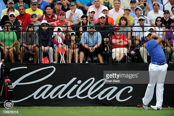 Jhonattan Vegas of Venezuela hits from the first tee box during the first round of the World Golf ChampionshipsCadillac Championship at TPC Blue...