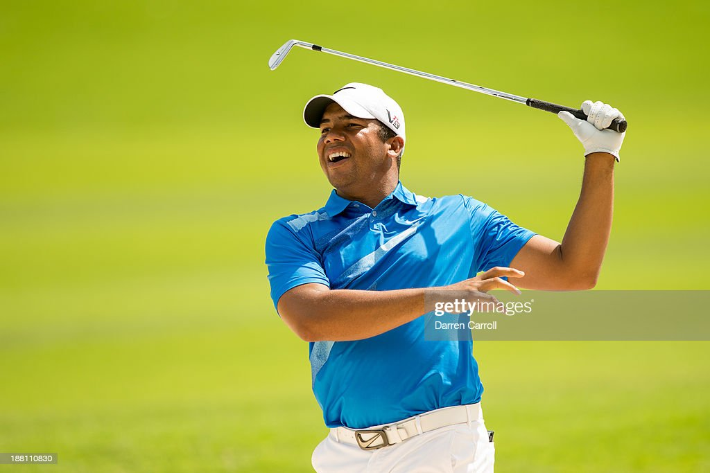 Jhonattan Vegas of Venezuela plays a bunker shot at the eighteenth hole during continuation of the first round of the 2013 OHL Classic at Mayakoba, played at El Camaleon Golf Club on November 15, 2013 in Playa Del Carmen, Mexico.