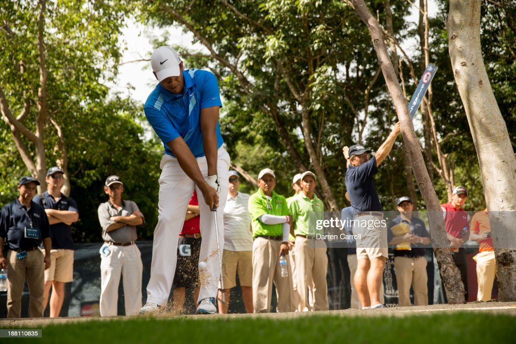 Jhonattan Vegas of Venezuela plays a shot from a waste area at the eighteenth hole during continuation of the first round of the 2013 OHL Classic at Mayakoba, played at El Camaleon Golf Club on November 15, 2013 in Playa Del Carmen, Mexico.