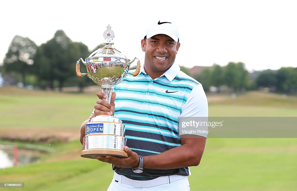 Jhonattan Vegas of Venezuela poses with the trophy after winning during the final round of the RBC Canadian Open at Glen Abbey Golf Club on July 24, 2016 in Oakville, Canada.