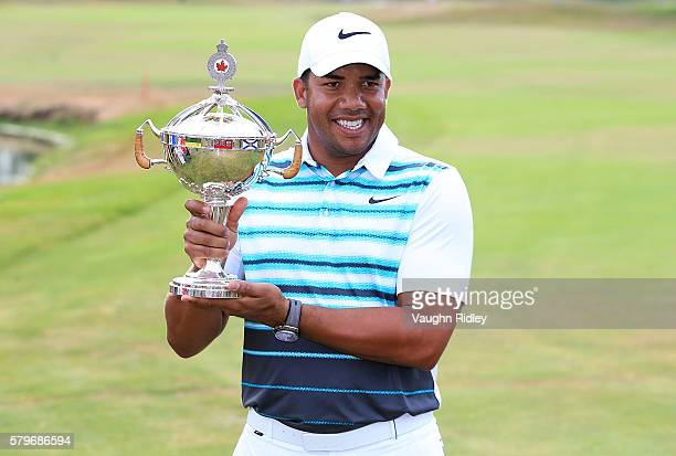 Jhonattan Vegas of Venezuela poses with the trophy after winning during the final round of the RBC Canadian Open at Glen Abbey Golf Club on July 24...