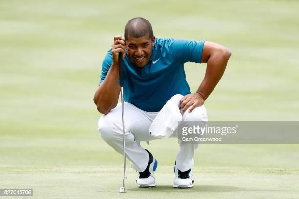 Jhonattan Vegas of Venezuela prepares to putt on the fifth green during the final round of the World Golf Championships Bridgestone Invitational at...