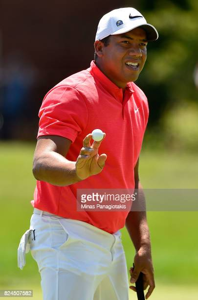Jhonattan Vegas of Venezuela reacts to his birdie putt on the second hole during the final round of the RBC Canadian Open at Glen Abbey Golf Club on...