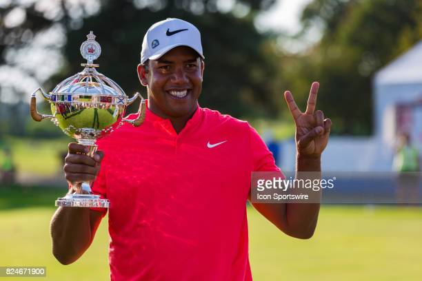 Jhonattan Vegas with the RBC Canadian Open Trophy shows two fingers after winning his second in a row RBC Canadian Open on July 30 at Glen Abbey Golf...