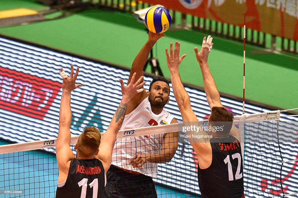 Jhonlenn Cruz Barreto Pena #2 of Venezuela spieks the ball during the Men's World Olympic Qualification game between Venezuela and Canada at Tokyo Metropolitan Gymnasium on June 1, 2016 in Tokyo, Japan.