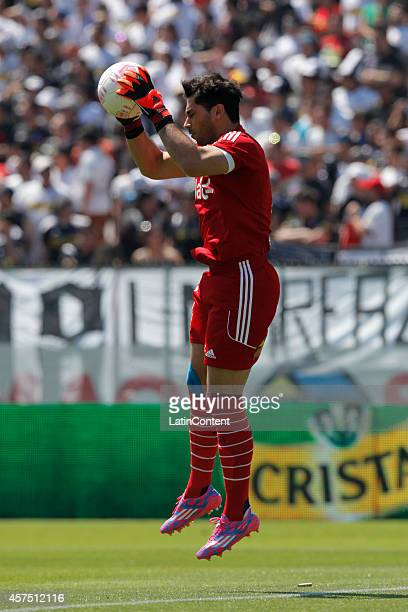 Jhonny Herrera goalkeeper of Ude Chile controls the ball during a match between Colo Colo and U de Chile as part of round 11 of Torneo Apertura 2014...