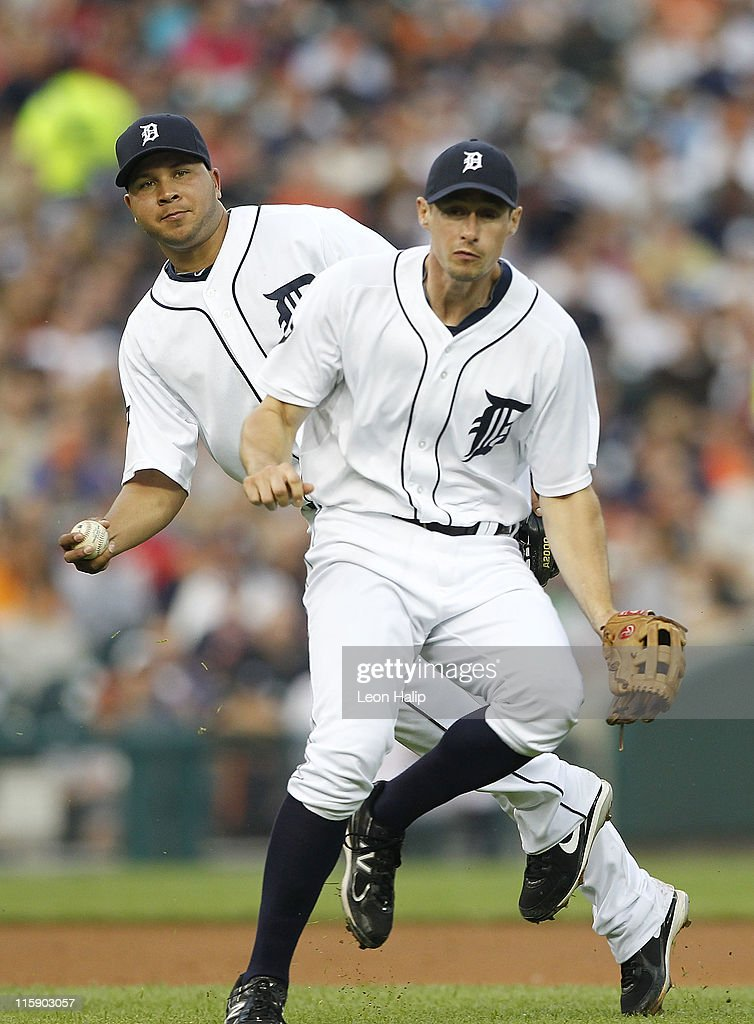 Jhonny Peralta #27 and Don Kelly #32 of the Detroit Tigers attempt to make the play on the infield single from Greg Halman #56 of the Seattle Mariners during the fifth inning of the game at Comerica Park on June 11, 2011 in Detroit, Michigan. The Tigers defeated the Mariners 8-1.
