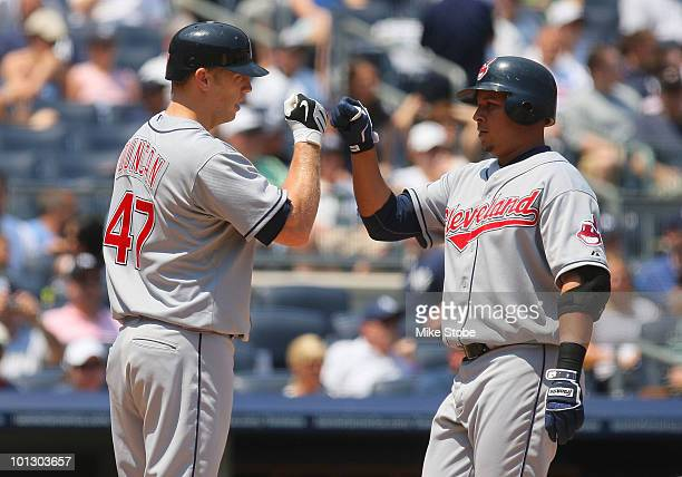 Jhonny Peralta of the Cleveland Indians is greeted by Shelley Duncan after hitting a solos homerun in the secondinning against the New York Yankees...