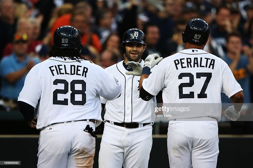 <a gi-track='captionPersonalityLinkClicked' href=/galleries/search?phrase=Jhonny+Peralta&family=editorial&specificpeople=213286 ng-click='$event.stopPropagation()'>Jhonny Peralta</a> #27 of the Detroit Tigers celebrates his three run home run in the fifth inning with <a gi-track='captionPersonalityLinkClicked' href=/galleries/search?phrase=Prince+Fielder&family=editorial&specificpeople=209392 ng-click='$event.stopPropagation()'>Prince Fielder</a> #28 and <a gi-track='captionPersonalityLinkClicked' href=/galleries/search?phrase=Alex+Avila&family=editorial&specificpeople=5749211 ng-click='$event.stopPropagation()'>Alex Avila</a> #13 during Game Four of the American League Division Series against the Oakland Athletics at Comerica Park on October 8, 2013 in Detroit, Michigan.