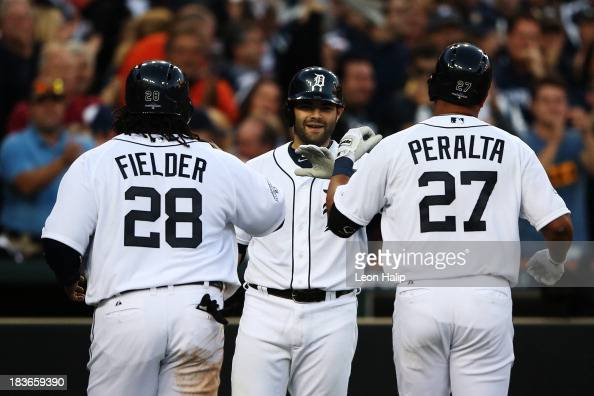 Jhonny Peralta of the Detroit Tigers celebrates his three run home run in the fifth inning with Prince Fielder and Alex Avila during Game Four of the...