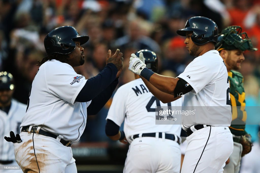 Jhonny Peralta #27 of the Detroit Tigers celebrates his three run home run in the fifth inning with Prince Fielder #28 during Game Four of the American League Division Series against the Oakland Athletics at Comerica Park on October 8, 2013 in Detroit, Michigan.