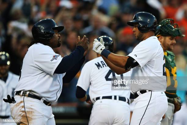 Jhonny Peralta of the Detroit Tigers celebrates his three run home run in the fifth inning with Prince Fielder during Game Four of the American...