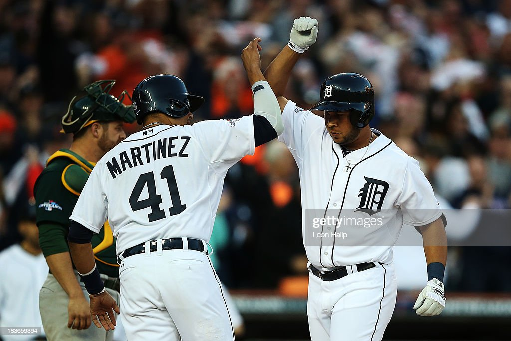 <a gi-track='captionPersonalityLinkClicked' href=/galleries/search?phrase=Jhonny+Peralta&family=editorial&specificpeople=213286 ng-click='$event.stopPropagation()'>Jhonny Peralta</a> #27 of the Detroit Tigers celebrates his three run home run in the fifth inning with Victor Martinez #41 during Game Four of the American League Division Series against the Oakland Athletics at Comerica Park on October 8, 2013 in Detroit, Michigan.