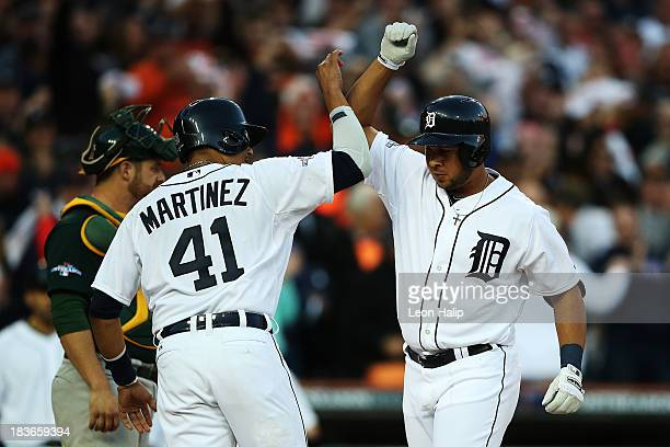 Jhonny Peralta of the Detroit Tigers celebrates his three run home run in the fifth inning with Victor Martinez during Game Four of the American...