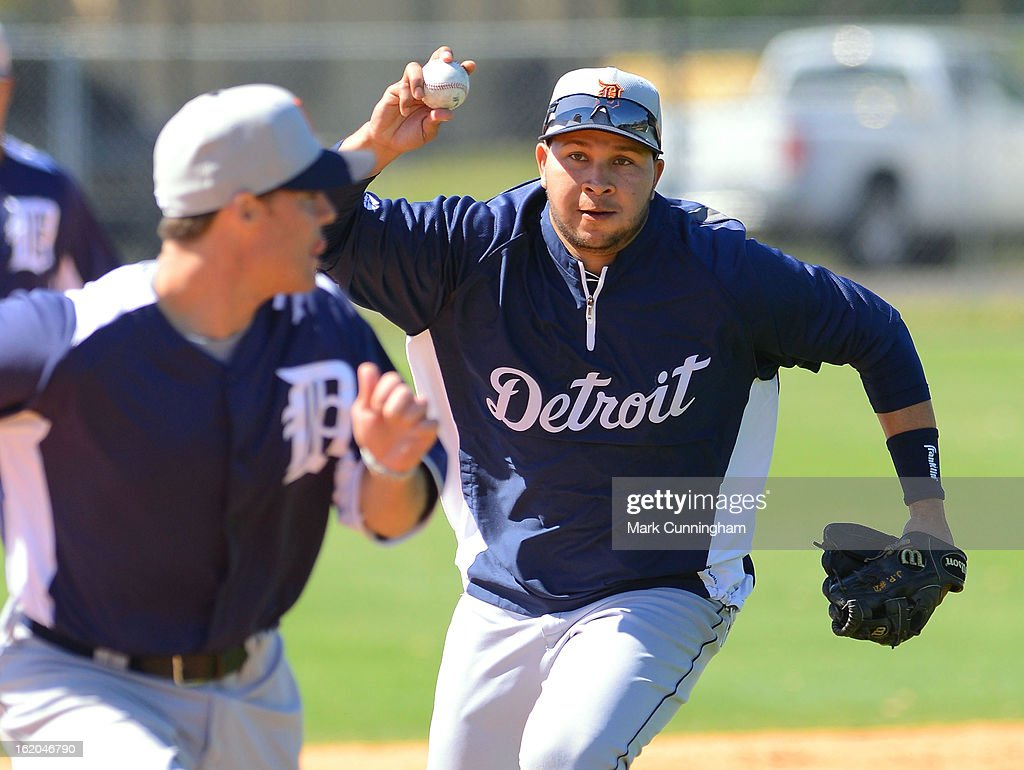 Jhonny Peralta #27 of the Detroit Tigers chases down a runner during Spring Training workouts at the TigerTown Facility on February 18, 2013 in Lakeland, Florida.