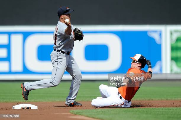 Jhonny Peralta of the Detroit Tigers forces out Nate Mclouth of the Baltimore Orioles to start a double play in the first inning at Oriole Park at...