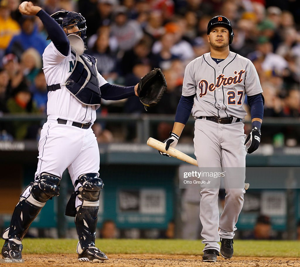 Jhonny Peralta #27 of the Detroit Tigers heads back to the dugout after striking out in the seventh inning as catcher Kelly Shoppach #7 of the Seattle Mariners throws the ball back to the pitcher at Safeco Field on April 18, 2013 in Seattle, Washington.