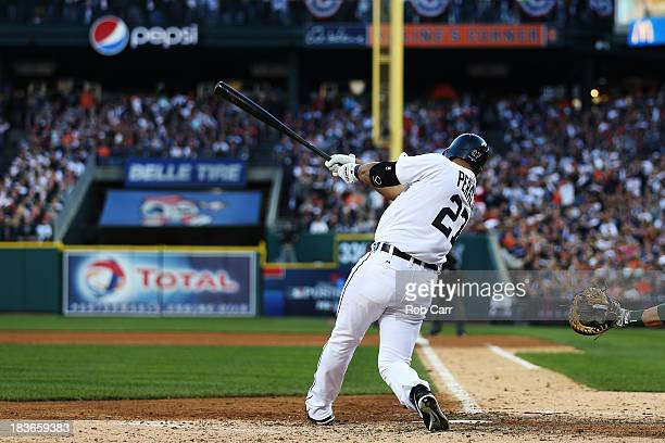 Jhonny Peralta of the Detroit Tigers hits a three run home run in the fifth inning against the Oakland Athletics during Game Four of the American...