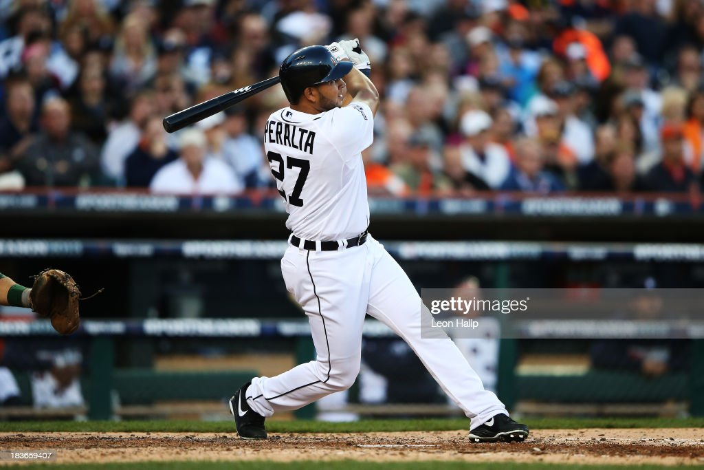 <a gi-track='captionPersonalityLinkClicked' href=/galleries/search?phrase=Jhonny+Peralta&family=editorial&specificpeople=213286 ng-click='$event.stopPropagation()'>Jhonny Peralta</a> #27 of the Detroit Tigers hits a three run home run in the fifth inning against the Oakland Athletics during Game Four of the American League Division Series at Comerica Park on October 8, 2013 in Detroit, Michigan.