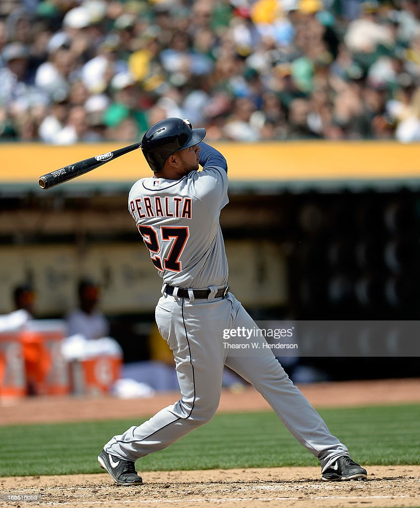 <a gi-track='captionPersonalityLinkClicked' href=/galleries/search?phrase=Jhonny+Peralta&family=editorial&specificpeople=213286 ng-click='$event.stopPropagation()'>Jhonny Peralta</a> #27 of the Detroit Tigers hits a three-run home run against the Oakland Athletics in the fouth inning at O.co Coliseum on April 13, 2013 in Oakland, California.