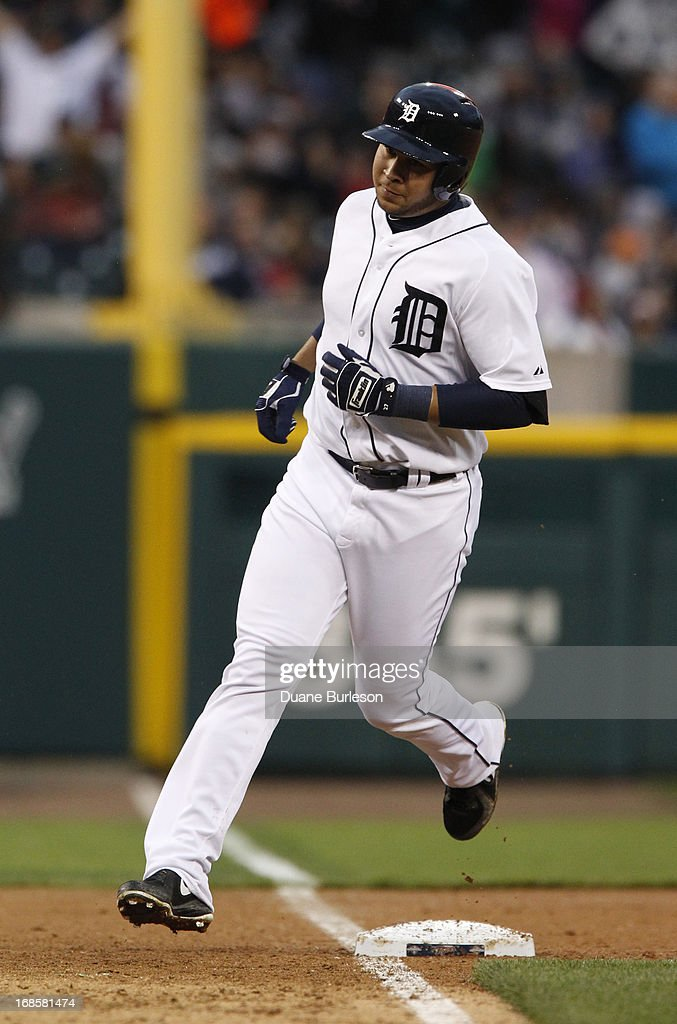 <a gi-track='captionPersonalityLinkClicked' href=/galleries/search?phrase=Jhonny+Peralta&family=editorial&specificpeople=213286 ng-click='$event.stopPropagation()'>Jhonny Peralta</a> #27 of the Detroit Tigers rounds the bases after hitting a home run against the Cleveland Indians in the third inning at Comerica Park on May 11, 2013 in Detroit, Michigan.