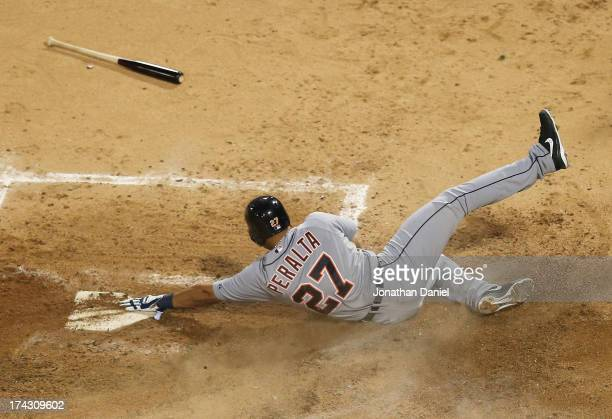 Jhonny Peralta of the Detroit Tigers slides across home plate to score a run in the 4th inning against the Chicago White Sox at US Cellular Field on...