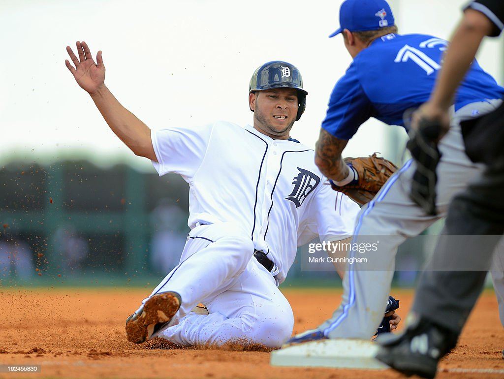 Jhonny Peralta #27 of the Detroit Tigers slides into third base during the spring training game against the Toronto Blue Jays at Joker Marchant Stadium on February 23, 2013 in Lakeland, Florida. The Blue Jays defeated the Tigers 10-3.
