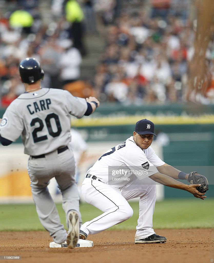 Jhonny Peralta #27 of the Detroit Tigers tags second base and forces out Mike Carp #20 of the Seattle Mariners during the fifth inning of the game at Comerica Park on June 11, 2011 in Detroit, Michigan. The Tigers defeated the Mariners 8-1.