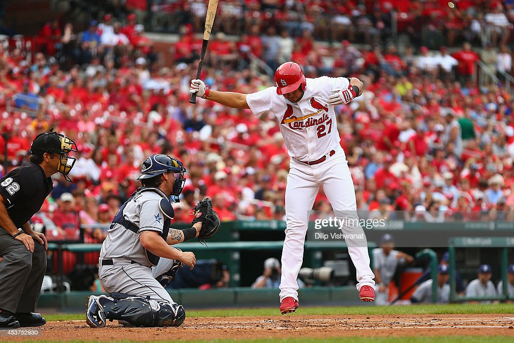 Jhonny Peralta #27 of the St. Louis Cardinals avoids an inside pitch during an at bat against the San Diego Padres in the first inning at Busch Stadium on August 17, 2014 in St. Louis, Missouri. The Cardinals beat the Padres 7-6.