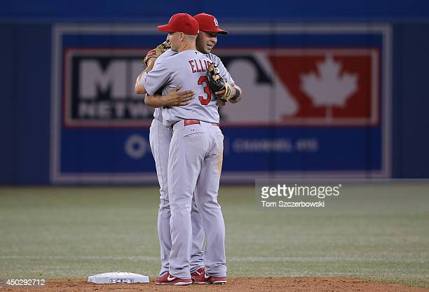 Jhonny Peralta of the St Louis Cardinals celebrates a victory with Mark Ellis during MLB game action against the Toronto Blue Jays on June 8 2014 at...